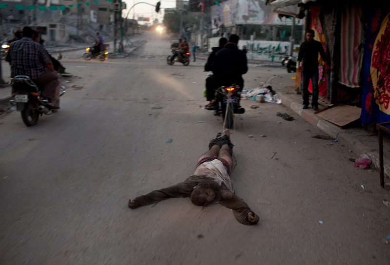 """""""Suspected collaborator"""" dragged through streets of Gaza behind motercycle."""