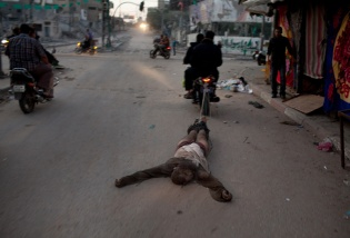 """Suspected collaborator"" dragged through streets of Gaza behind motercycle."