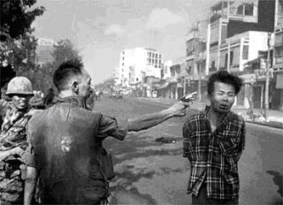 General Nguyen Ngoc Loan executes Viet Cong death squad member. Photo by Eddie Adams .
