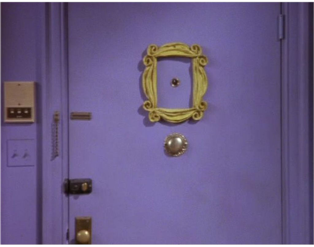 Famous picture frame around peephole from Friends TV show.